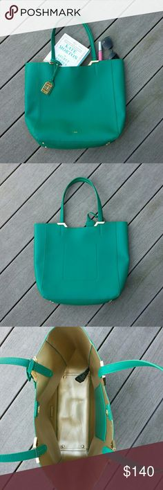 Green tote bag Pebbled texture, emerald green color. Gold colored interior with a pouch pocket. Magnetic snap closure.  No trades.  Save even more with a bundle discount! Lauren Ralph Lauren Bags Totes