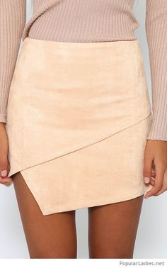 A nude velvet skirt with a nude blouse