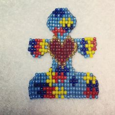 autism puzzle piece (altered from my original pattern)  size 11 seed beads; square stitch