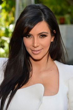 I can't stand Kim Kardashian, but I love her hair.  This is my new hair goal!