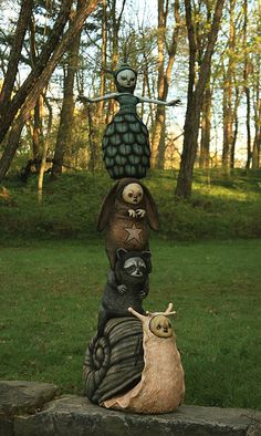 Garden gnomes. Take the idea of Gnomes sitting outside in gardens and pots... what other creatures can be created like gnomes?? Zombie  elves, vampire fairies, gothic gnomes,...