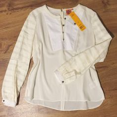 Tory Burch silk top Gorgeous Tory burch blouse with ruffled detailing on the sleeves. The front has a panel of slightly more opaque material with buttons. This top is in excellent condition: NWT. It is a size 14, but has a drapey fit that could work for a size 12 easily. I'm heartbroken to have to sell this, but it is not the right size for me and has been sitting in my closet unloved for too long. Tory Burch Tops Blouses