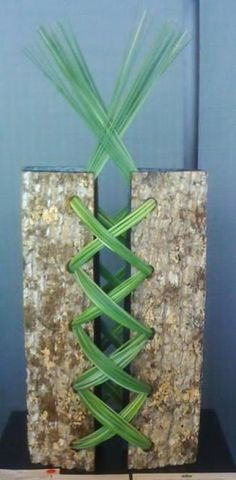 this would be fun with long stems of flowers out of the center also and ribbon of choice could be used....This says:  annual GCA entry