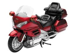 New-Ray Toys 1:12 Honda Goldwing Plastic Model Motorcycle 57253R This Honda Goldwing (2010) Plastic Model Motorcycle is Metallic Red and features working stand, steering, wheels. It is made by New-Ray Toys and is 1:12 scale (approx. 15cm / 5.9in long).    #New-RayToys #ModelMotorbike #Honda #MiniModelBikes