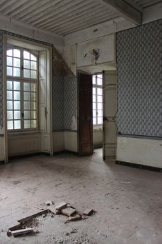 Peeling wallpaper in the Château's many rooms hints at the many layers beneath.