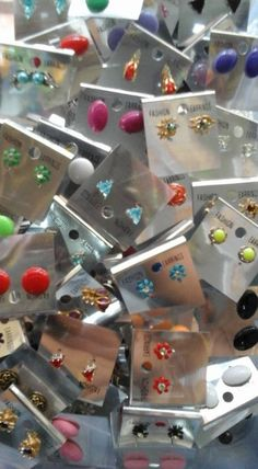 Box of 50 Assorted earrings.  Designs and colours as per availability.