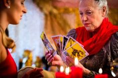 Fortuneteller laying tarot cards with cl. Fortune Teller, Tarot Readers, Oracle Cards, Tarot Cards, The Magicians, Playing Cards, Photo Book, Hands, Woman