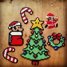 Christmas Mario perler beads by dementhea perler,hama,square pegboard,video… Perler Bead Designs, Pearler Bead Patterns, Diy Perler Beads, Perler Patterns, Pearler Beads, Fuse Beads, Perler Bead Mario, Christmas Perler Beads, Art Perle