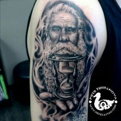 Black and gray father time piece with hourglass