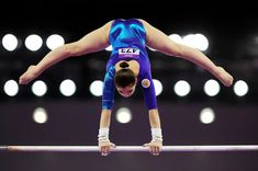Aliya Mustafina of Russia competes on the Uneven Bars in the Women's Individual All-Around final on day six of the Baku 2015 European Games at National Gymnastics Arena on June 2015 in Baku, Azerbaijan. Elite Gymnastics, Amazing Gymnastics, Gymnastics Photography, Gymnastics Pictures, Artistic Gymnastics, Olympic Gymnastics, Gymnastics Girls, Sports Pictures, Rhythmic Gymnastics