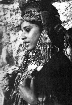 """Bride from the southern Hebron Hills, wearing a 'money hat'    ©Shelagh Weir """"Palestine Costume"""", British Museum Publication, London. 1989.  Pg 187"""