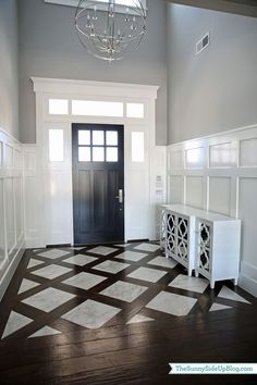 floor design could do this look in foyer but with wood look tile as the dividing pieces not true wood would have to find a wood tile close to the color of the wood floor we want Decor, Home, House Styles, House Design, Home Remodeling, New Homes, Interior Design, Floor Design, House Interior