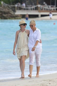 Pin for Later: You'll Need to Cool Off After Seeing These Sexy Celebrity Beach PDA Pictures Ellen DeGeneres and Portia de Rossi took a romantic walk on the beach during a St. Barts getaway in December Ellen Degeneres And Portia, Ellen And Portia, Portia De Rossi, Cool Inventions, Beach Walk, Panama Hat, White Dress, Take That, St Barts