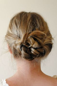 braid hair in pigtails. Tie braids in a knot. Pin back whatever hair is flipping out.