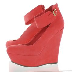 These platform shoes are mamey orange and are a little high also has a buckle…