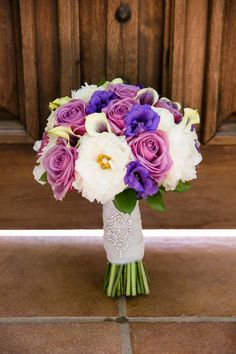 Radiant orchid inspired bridal bouquet.  Picasso calla lilies, lisianthus, roses, with tulle wrapped stems and crystal applique