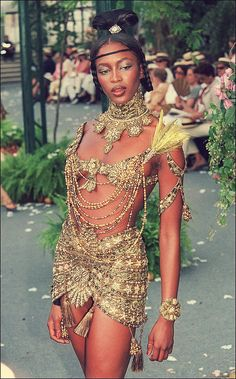 Naomi Campbell. This looks like it fits the belly dancing page best.