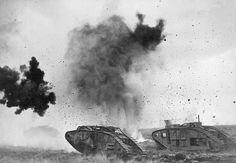Europe c. 1917British tanks in action during WWI with German shells bursting around them.