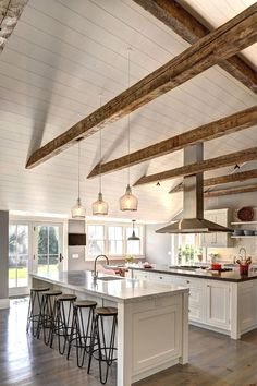 Ranch Cottage with Transitional Coastal Interiors. The kitchen feels spacious wi… Ranch Cottage with Transitional Coastal Interiors. The kitchen feels spacious with its beamed cathedral ceiling and double islands. House Design, House, Home, Coastal Interiors, Kitchen Remodel, House Styles, Luxury Homes, New Homes, House Interior