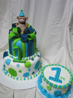 https://flic.kr/p/a2Y5gX | First birthday boy cake | First birthday boy cake with lime green, light blue and dark blue polka dots and present second tier with bow and little monkey on top.