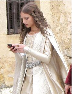 Isabel texting lol :D okay. I want your hair and dress.