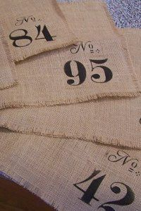 Stenciled burlap placemats...stencils can be purchased here:  http://www.maisondestencils.com/alphabet-and-number-stencils