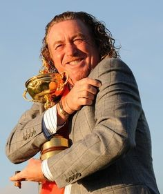 Europe Ryder Cup player Miguel Angel Jimenez poses for pictures with the Ryder Cup after Europe beat the US by 14 1/2 points to 13 1/2 points on the final day of the 2010 Ryder Cup golf competition at Celtic Manor golf course in Newport, Wales on October 4, 2010.