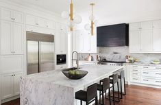 Marble waterfall island / black metal range hood / our Hinsdale pendants🙌🙌 Design: Home Renovation, Home Remodeling, Kitchen Remodeling, Toronto, Home Upgrades, Kitchen Reno, Kitchen Ideas, Kitchen Islands, Interior Lighting