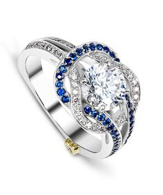 The Entangle engagement ring contains 49 diamonds totaling 0.245ctw and 41 sapphires totaling 0.205ctw. Center stone sold separately, not included in price.The Entangle wedding band contains 46 diamonds, totaling 0.23ctw.
