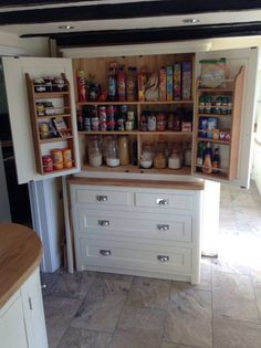 Amazing larder unit made from popular timber and painted in Farrow and Ball's Pointing. Complete with Oak spice racks on the back of the doors. You can purchase this from us for £950.