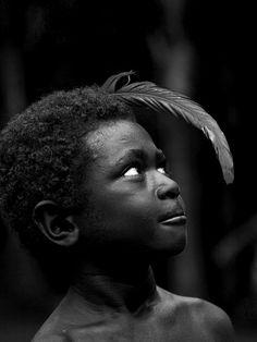 Boy with a feather in the hair, Malekula island, Vanuatu, via Flickr.