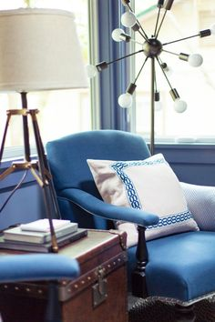 Brian Patrick Flynn had fun with lighting in this space. The style combinations add visual interest to the entire room. *Storage bonus: Hide odds and ends in the trunk that acts as a side table. >> http://www.hgtv.com/design/hgtv-urban-oasis/2015/living-room-pictures-from-hgtv-urban-oasis-2015-pictures?soc=pinterest