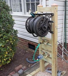 """Inspiration for my """"faucet extension""""...making water more accessible & programmable while on vacation {DIY Hose Reel Stand} with {Outdoor Faucet Extension and Remote!}"""