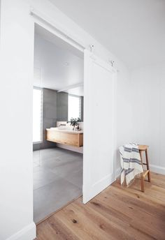 15 bathrooms with clever ideas to steal **Sliding doors** Ideal when working within limited floorspace, or for breaking up an expanse of white walls, an oversized barn door is a chic element that adds interest and a hint of rustic style to a contemporary White Bathroom, Modern Bathroom, Small Bathroom, Bathroom Ideas, Shower Ideas, Bathroom Designs, Sliding Door For Bathroom, Bathroom Interior, The Block Bathroom