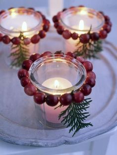 String cranberries and tie an evergreen twig and place around votive. Elegant looking.
