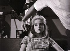 Director Stanley Kubrick took this photo of Sue Lyon being primped by the make up artist on the set of Lolita.