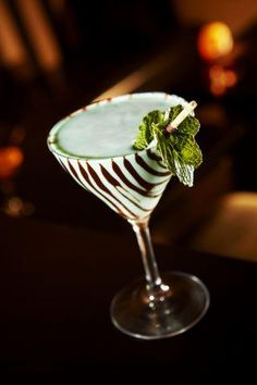 Sip on this!  Choco Mint Cream  2 parts Pinnacle® Chocolate Whipped® Vodka  1 part DeKuyper® Peppermint Schnapps  1 part DeKuyper® Green Crème de Menthe  1 part Half & Half  Shake with ice and strain into a chocolate sauce striped martini glass. #drinks #cocktails