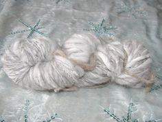 Soft and Luxurious Angora yarn.  Knits beautifully into one of a kind items. Single ply worsted weight super soft handspun yarn