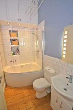 New corner bath with curved glass shower screen installed by our team of selected bathroom fitters with WC re positioned to make better use of the space within the bathroom and to give a great sens… Small Full Bathroom, Small Bathtub, Small Corner Bath, Corner Bathtub, Bathroom Design Layout, Bathroom Design Small, Bathroom Tub Shower, Glass Shower, Bathtub Shower Combo