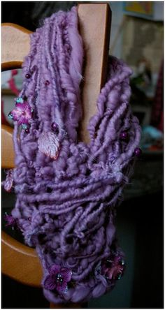 Yarn by Ama Yaga - Merino Fiber, petaloo and beads.