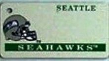 """This is an NFL Seattle Seahawks Team License Plate Key Chain or Tag. An excellent and affordable gift for an avid NFL fan! The key chain is available with engraving or without engraving. It is a standard key chain made of durable plastic and size is approximately 1.13"""" x 2.25"""" and 1/16"""" thick."""