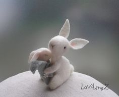 Felt mini mommy and baby bunny :   This sweet little bunny mommy is lovingly carrying her sleeping baby, wrapped in a sweet and soft blue blanket. A unique and adorable gift for mothers Day, new birth, baby shower, or just to enjoy the magical sweet world the LoveLingZ cuties take you to...  They are made of soft off- white 100% wool felt , stuffed with sheep wool and a little cotton. The blanket of the baby is made of soft blue/ gray wool felt, it can not be taken off.  Mommys arms can ...