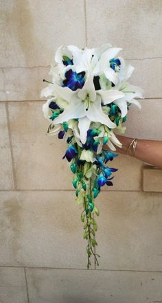 White oriental lilies and blue orchids