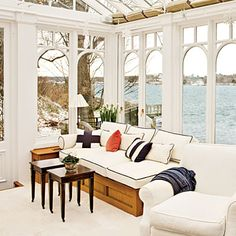 Inside this wood-and-glass conservatory just above the high tide line, built-in furnishings and mahogany walls wrap the tiny space, creating the sense of being on a yacht.