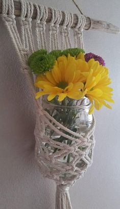 This item is made to order and will vary slightly from the photos above. I do my best to find similar materials, while also making each piece unique and one-of-a-kind. Listing includes one hanger and a mason jar or glass vase. Sorry, flowers not included. Approximate Size: Length: 12 inches