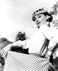 Audrey Hepburn posing with a table a cloth and bread basket on the set of Love in the Afternoon, Paris, France, 1956. The girl can make anything stylish.