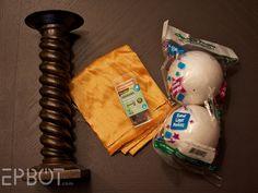 pretty candlestick, half of a hard foam ball, a bit of padding, fabric, and long push pins