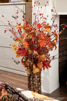 Use faux-floral stems for a flower arrangement that will last all the way through the chilly days of Fall and Winter and straight into Spring.