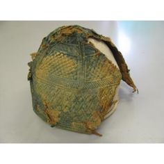cap Date: 1250-1517 Dimensions: top of crown to lower edge: 15.8 cm (6 1/4 in.) Other (Intact areas of circumference): 43.5 cm (17 1/8 in.) Medium: linen, metallic thread Egypt  A round cap. The cap is quilted with similar cut and construction of the internal and external fabric layers. The quilting (back stitch) is supported internally by cellulosic(?) cord held with decorative stitching of linen thread. The fabric is plain woven, possibly linen.
