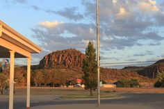 Sleeping Lion Mountain backs the historic fort, as seen from the Fort Davis Texas post office. Fort Davis Texas, Sleeping Lion, West Texas, Post Office, Painting Tips, Places To Eat, Wind Turbine, Cook, Artists